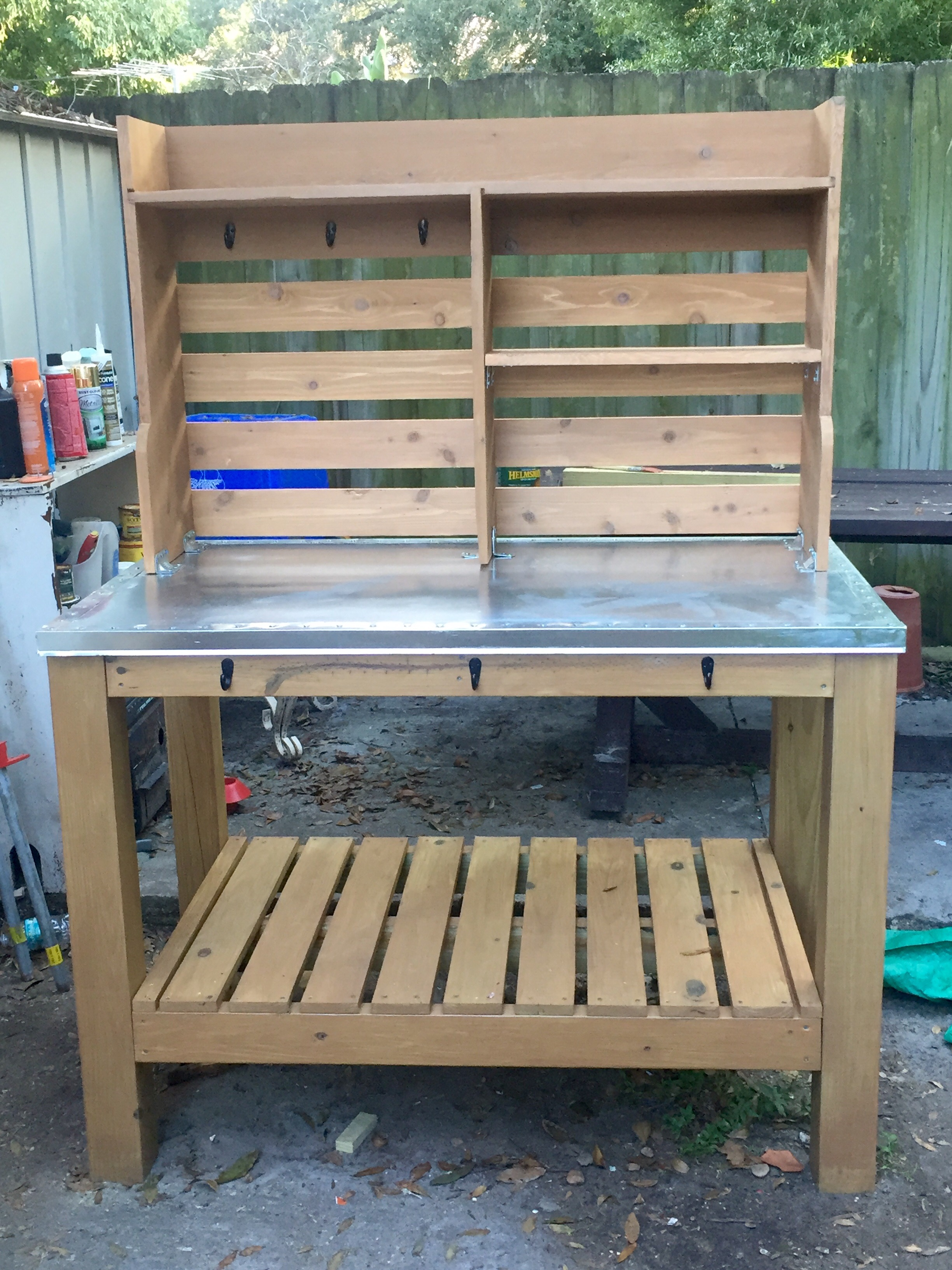 station wooden modern folding to plans inexpensive a garden with ideas outdoor how table of potting ikea rubbermaid curved size make shelves full bench planter